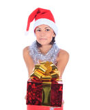 Christmas woman in santa hat holding gift Stock Images