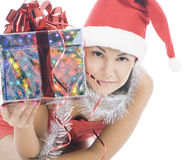 Christmas woman in santa hat holding gift Royalty Free Stock Image