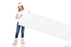Christmas woman in santa hat pointing empty board Royalty Free Stock Images