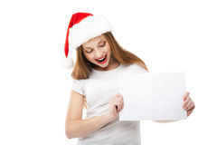 Christmas woman in santa hat pointing empty board Royalty Free Stock Photo