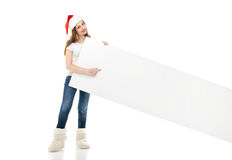 Christmas woman in santa hat pointing empty board Royalty Free Stock Photography