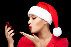 Christmas Woman in Santa Hat Taking a Selfie Sending Kisses Stock Image