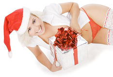 Christmas woman in santa hat and white stockings Royalty Free Stock Photography