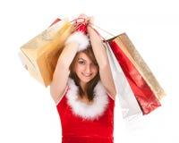 Christmas woman shopping. Young christmas woman holding shopping bags Stock Photo