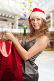 Christmas woman shopping Royalty Free Stock Image