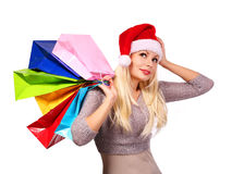 Christmas woman with shopping bags. Girl with Santa Hat isolated Stock Photography