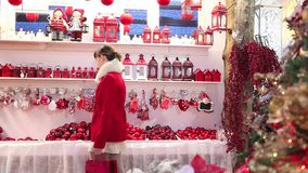 Christmas woman shopping decorations in market stock footage