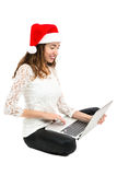 Christmas woman shopping online Stock Photos