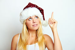 Christmas woman is showing Stock Photography