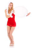 Christmas woman showing advert. Happy christmas woman showing blank oval advert isolated on white Royalty Free Stock Photos