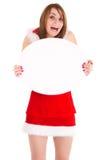 Christmas woman showing advert. Happy christmas woman showing blank oval advert isolated on white Stock Photography