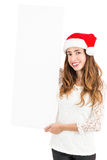 Christmas woman showing advertising banner Royalty Free Stock Image