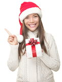 Christmas woman showing copy space Royalty Free Stock Photos