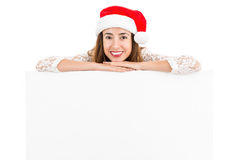 Christmas woman showing copy space Royalty Free Stock Images