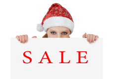 Christmas woman is showing empty billboard. Christmas Santa woman is showing blank empty billboard. sale royalty free stock photography