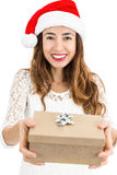 Christmas woman showing her gift box Royalty Free Stock Images