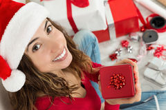 Christmas woman showing her gift happily Stock Image
