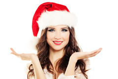 Christmas Woman Showing Open Palms. Chooses Royalty Free Stock Images