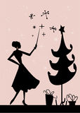 Christmas woman silhouette. In front of a Christmas tree,  illustration Royalty Free Stock Photos