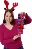 Christmas woman with silly holiday headband. Royalty Free Stock Photo