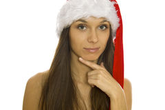 Christmas woman with smiling. Santa woman wearing Santa hat. Christmas woman portrait of a cute, beautiful Caucasian model. Isolated on white background Royalty Free Stock Photos