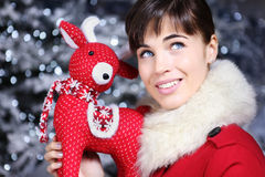 Christmas woman smiling with reindeer toy and look up Stock Photo