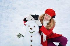 Christmas woman and a snowman Stock Photos