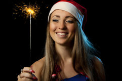 Christmas Woman with sparkler. Smiling Christmas Woman with glowing sparkler Royalty Free Stock Photos
