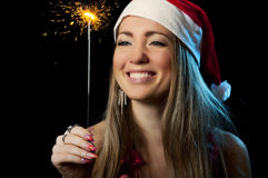 Christmas Woman with sparkler. Smiling Christmas Woman with glowing sparkler Stock Photography