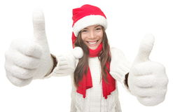 Christmas woman success. Christmas woman thumbs up success hand sign. Young smiling woman in Santa hat and warm winter sweater. Isolated on white background Stock Images