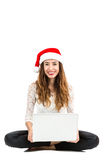 Christmas woman surfing on her laptop Stock Photo