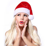 Christmas Woman. Surprised Beautiful Blonde Girl in Santa Hat Royalty Free Stock Photo