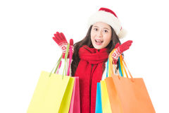 Christmas woman surprised face. carrying colorful shopping bags Stock Images
