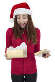 Christmas woman surprised by her gift box Stock Image
