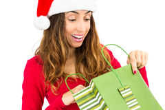 Christmas woman surprised about her gift Stock Image
