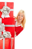 Christmas: Woman With Surprised Look From Behind Stack Of Gifts Royalty Free Stock Photo