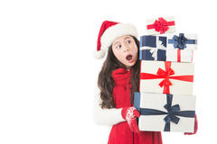 Christmas woman surprised looking many gifts and happy Stock Photography