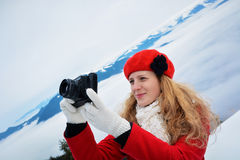 Christmas woman taking pictures Royalty Free Stock Image