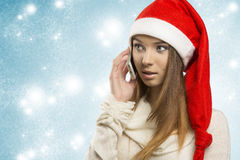 Christmas woman talking on the smartphone Royalty Free Stock Photos