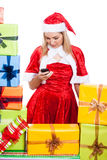 Christmas woman texting message Stock Images