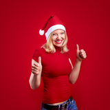 Christmas woman with thumbs up. Pretty girl with thumbs up on christmas Stock Photos