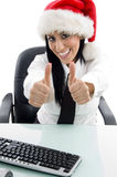 Christmas woman with thumbs up Royalty Free Stock Photos