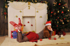 Christmas woman  with tree and chimney Stock Photo