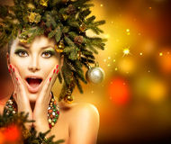 Christmas Woman. Christmas Tree Holiday Hairstyle and Makeup Royalty Free Stock Photos