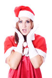 Christmas woman wearing a santa hat Stock Photos