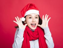 Christmas woman wearing santa hat and surprised Royalty Free Stock Photography