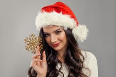 Christmas woman wearing santa hat with winter snowflake decor. Ation. Woman Christmas Concept Royalty Free Stock Images