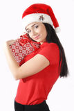 Christmas woman on white background with a gift Royalty Free Stock Image