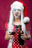 Christmas woman with wine Royalty Free Stock Image