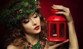Christmas Woman wish lantern Stock Photos